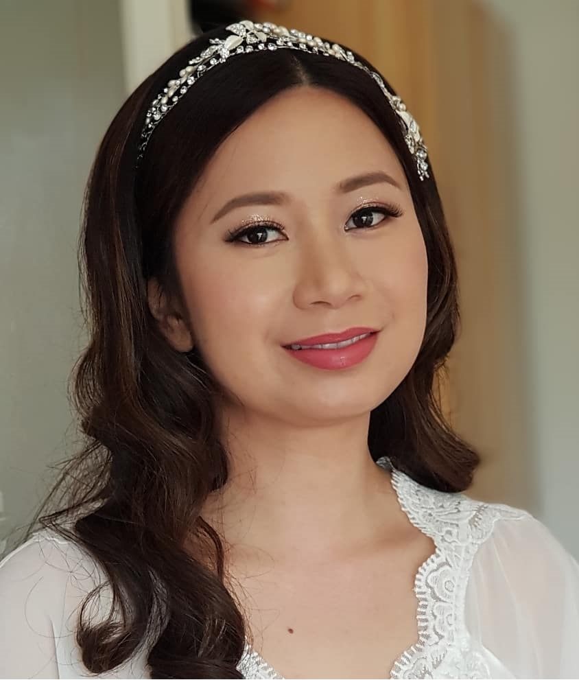 sydney bride with natural makeup and wearing wavy down hairstyle with a tiara.